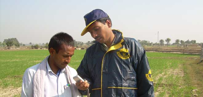 Farmers use phones to improve their lot in Uttar Pradesh India. Visit Lifelines India  Close