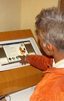Poor people use infokiosks to get their social security for NREGA benefits in Rajasthan India